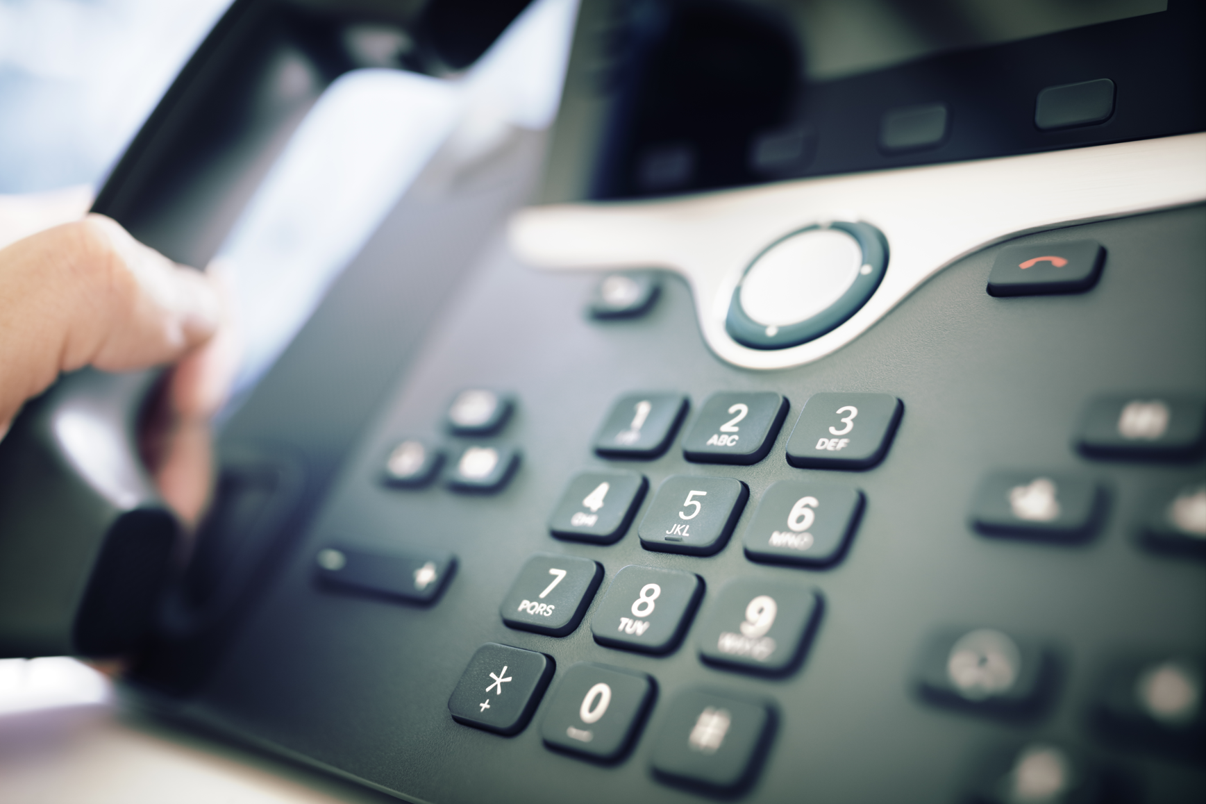 dialing-a-telephone-in-the-office-PWLAMGX